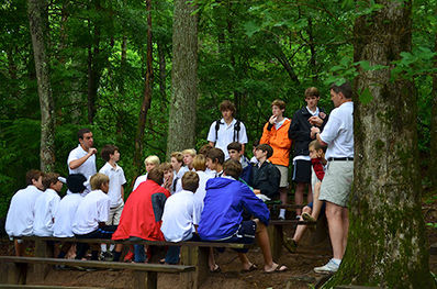 "The boys also hold elections once a week to add campers whom they have seen deserve to be a part of the group. These new members are ""tapped out"" during the Sunday Campfire program and officially welcomed in front of the entire camp community."