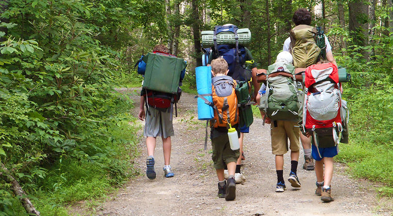 Except for long trips, where a boy may be carrying 1/4 to 1/3 his body weight in his pack, most boys will not need hiking boots. Trail-running shoes are fine, as are running or other types of comfortable/sturdy sneakers.