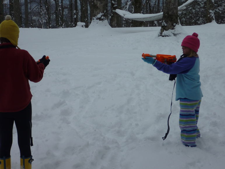 Mary and Annie in a Nerf Dart war at Falling Creek Camp