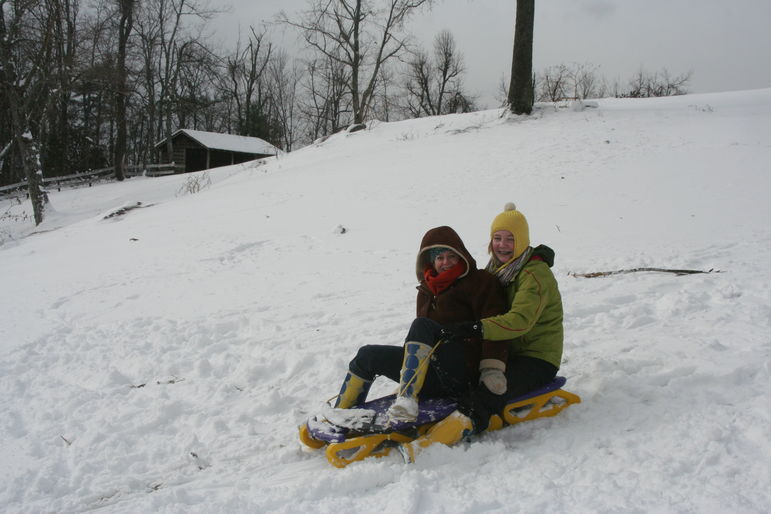 Marisa and Annie sledding at Falling Creek Camp