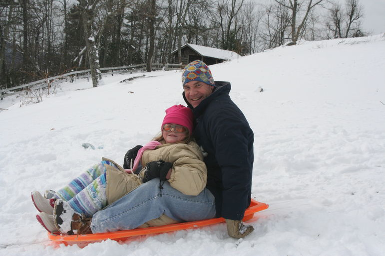 Yates and Mary going sledding at Falling Creek Camp