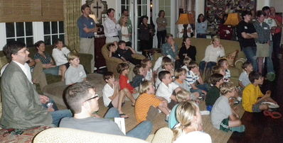 A Large group of Families in Nashville, TN watch the Falling Creek Camp Movie at The McKee's Home