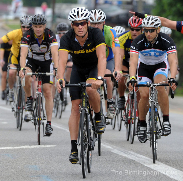 Dusty Davis (left) rides with Lance Armstrong