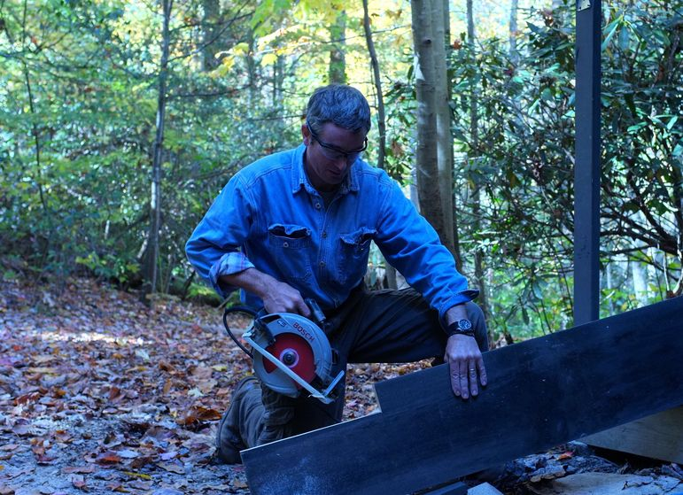 Bill Wilson making progress on the repairs to the campers cabins