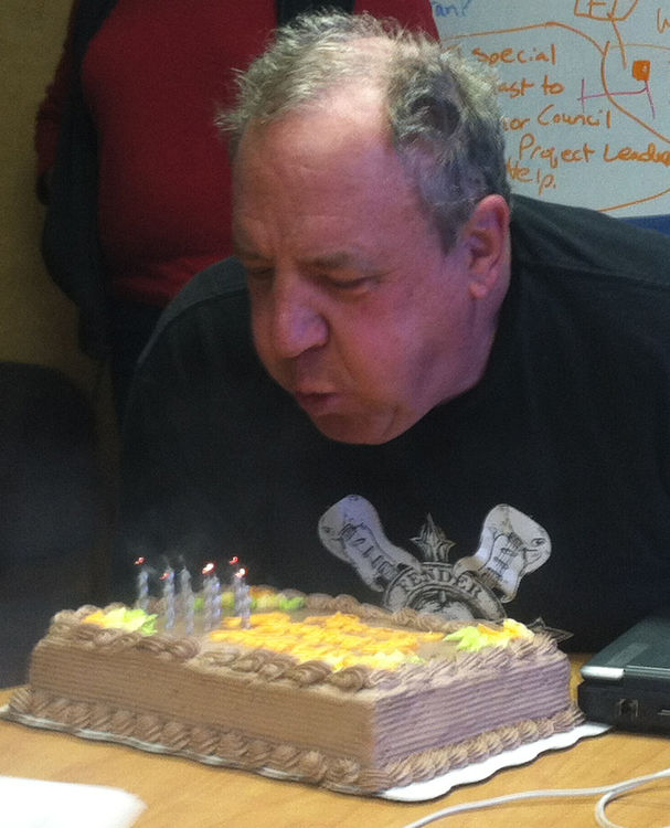 Col. Scotty blowing out the candles on his birthday cake
