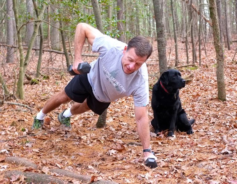Frank (and Lulu) at one of the exercise stations stations on the new Falling Creek Camp fitness trail