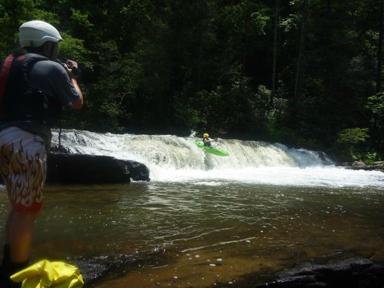 Tor Ramsey catching FCC campers on video as they launch off Second Ledge on the Chattooga River