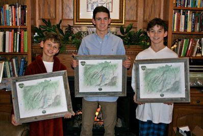 (l to r) Nathan Jess and Andrew are excited to receive their framed FCC Waypoints Maps on Christmas morning 2013.