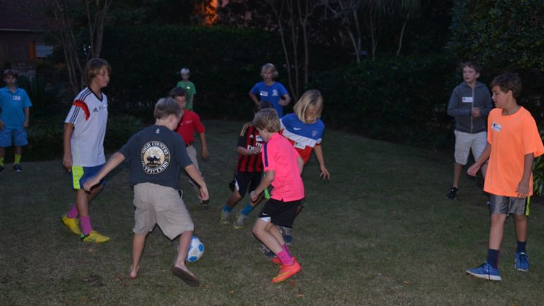 The boys enjoy playing a little soccer and eating some pizza before we all watch the new camp movie.