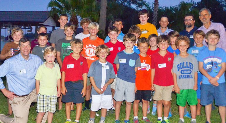 The returning campers, boys who came to learn about FCC, staff, alumni, and dads who have attended Father/Son Weekend, paused to have their group photo taken.