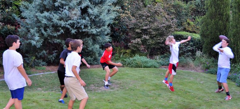 No surprise that a quick game of football started up in the back yard between the pizza and show time.