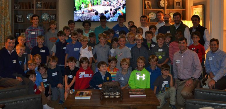 The returning campers, boys that came to learn more about Falling Creek, staff, alumni, and dads who have attended Father/Son Weekend, squeezed in for a great group photo in the Bissell's beautiful home.