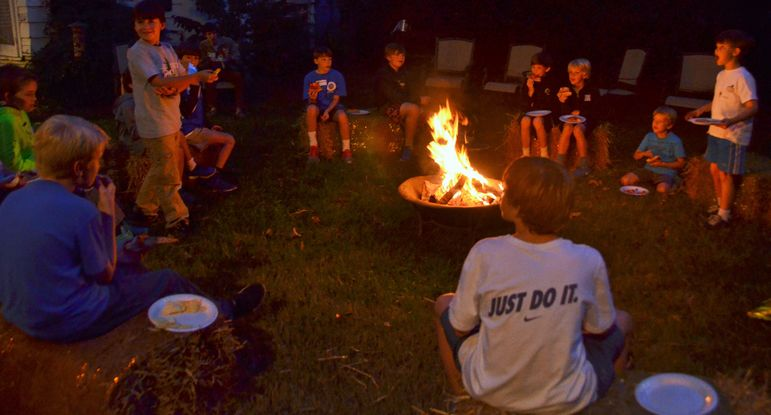 The Gettys' set up a wonderful campfire area in their back yard where the boys enjoyed eating and hanging out with each other in this perfect camp type setting.