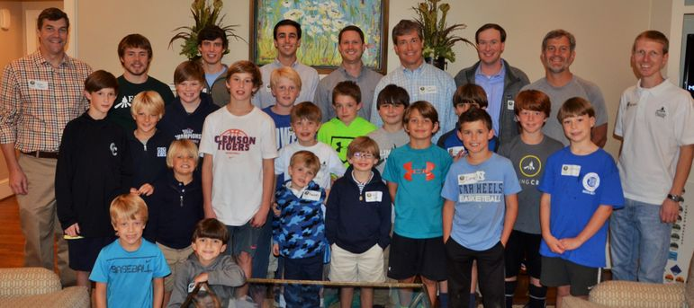 Returning campers, new boys who came to learn more about FCC, staff, alumni, and dads who have attended Father/Son Weekend, joined together for a group shot.