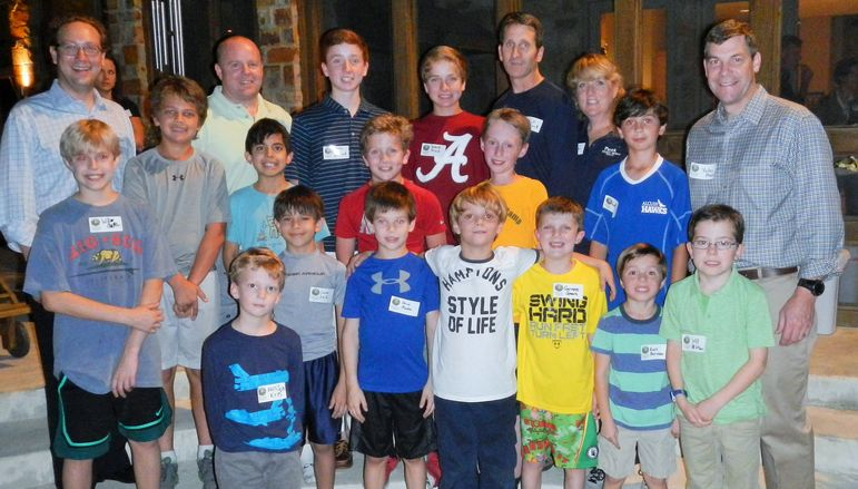Returning campers, boys who came to learn more about FCC, alumni, and dads who attended Father/Son Weekend pose for a group photo.