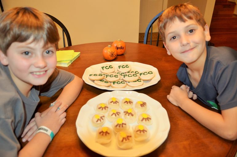 Webb and Boyd Hodges help their parents with hosting tonight and they were excited to show off the delicious FCC cookies and special cupcakes the Hodges prepared.  The boys will be returning to camp in 2016.