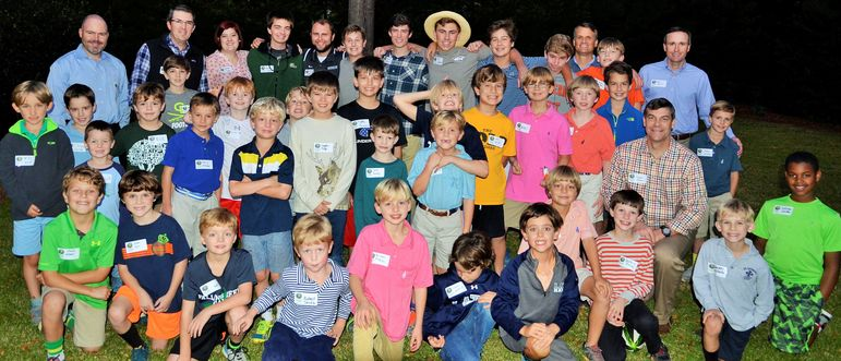Many of the campers and boys who came to learn more about Falling Creek were joined in a big group photo by FCC staff who live in the area and dads who have attended Father/Son Weekends or were campers at FCC when they were young.