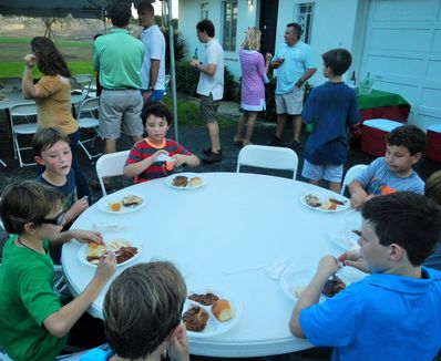 Enjoying each others company eating supper before the camp movie.