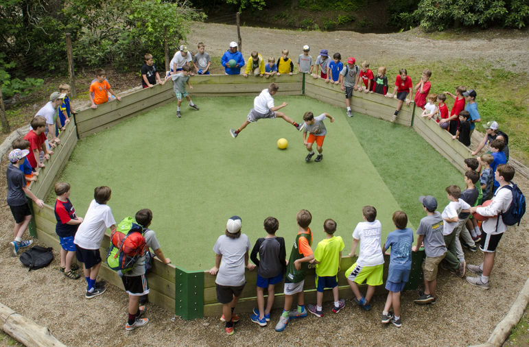 Warrior Ball is an outdoor form of dodgeball played in an octagon-shaped arena called a 'Warrior Ball Pit.' The game is similar to 'Ga-Ga Ball' or 'Pit Ball' and is believed to have it's origins in Israel where the word 'Ga' means hit. The game begins with two bounces of the ball, or 'Warrior Ball.'