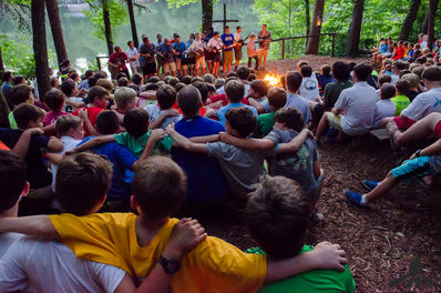 Our camp community gathers together at weekly campfires.
