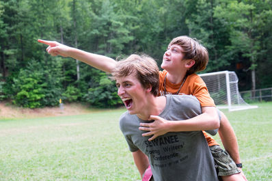 Camper and counselor goofing off at camp.