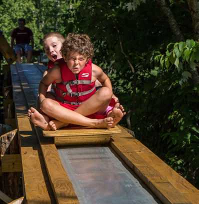 Our summer camp has a roller coaster that splashes into the lake!