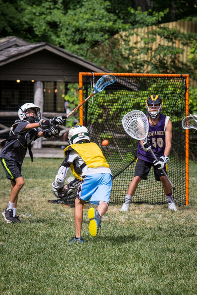 Campers playing Lacrosse at Falling Creek Camp.