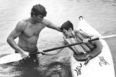 Yates teaches a camper how to roll in the 80's.