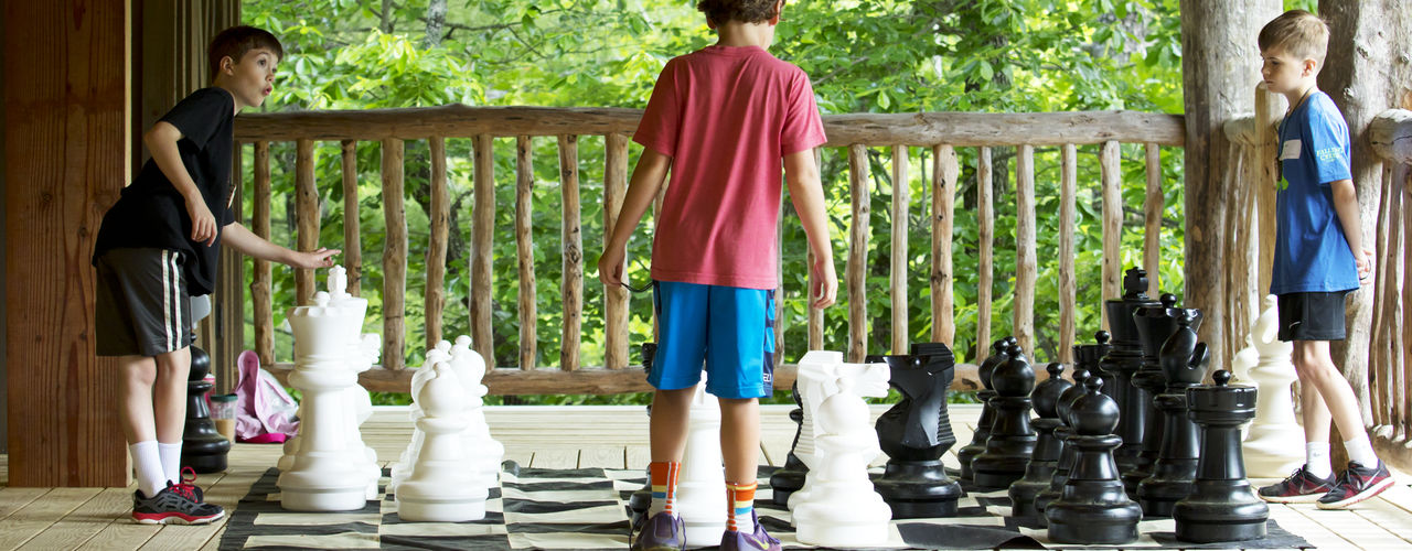 Campers-playing-giant-chess