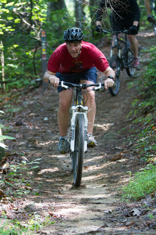 Staff member mountain biking on our extensive trail system at camp.