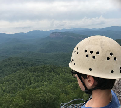 Camp climber looking out over Pisgah National Forest.