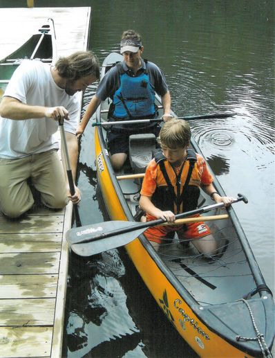 John teaching paddling at Father/Son Weekend