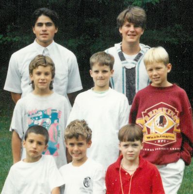 John, center of top row of campers, in 1993.