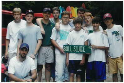 John, center with arm around Program Director Chris Stec, helped FCC win the the famous Bull Sluice award from a tough group of Camp Merrie-Woode paddlers in 2001.