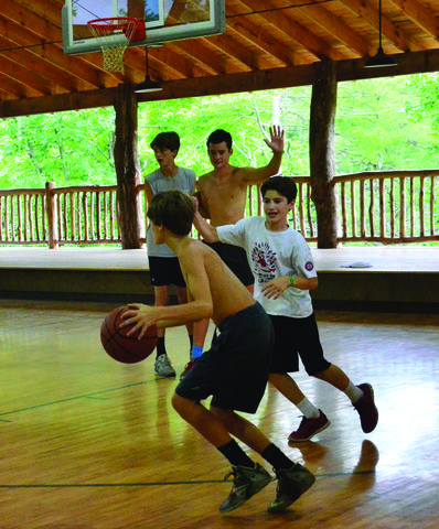 Campers playing basketball in our camp gymnasium.