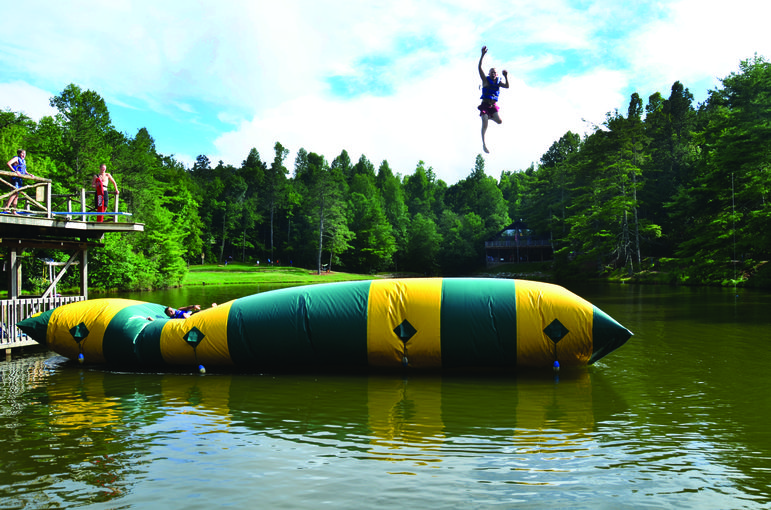 Campers enjoy the Blob at our camp swimming lake.