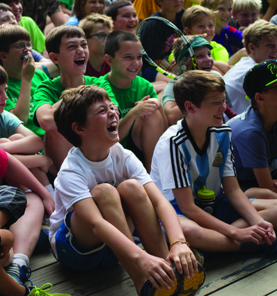 Campers have a laugh at our traditional morning assembly.