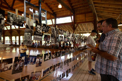 Simon Wilson looking over the decades of pictures strung around the McGrady Gym
