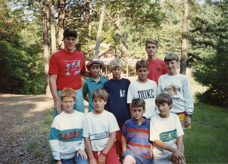 Yates with his June Camp Cabin in 1987, including a young Kelly Odom