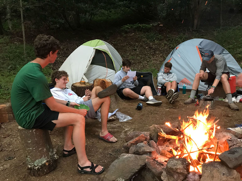 Without technology, there's even more time for bonding around the campfire during an out-of-camp trip.