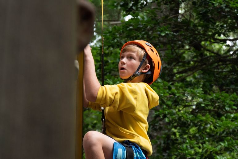 Will in one of his activities other than pottery, mastering the climbing wall