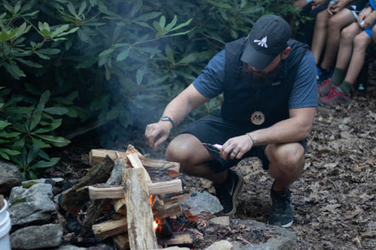 Kyle starting the campfire for Tuscarora's tribal campfire night