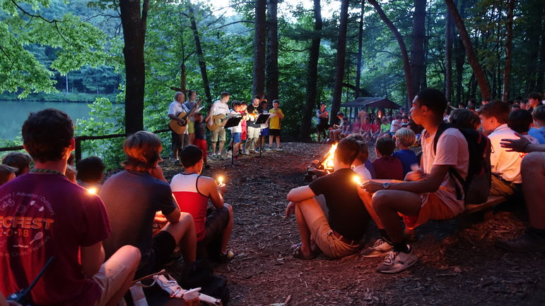 Lighting our candles to close out Campfire