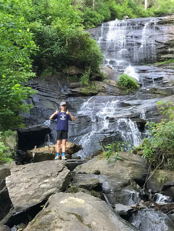 Stretching the legs at the base of Falling Creek Falls after a long day in the saddle