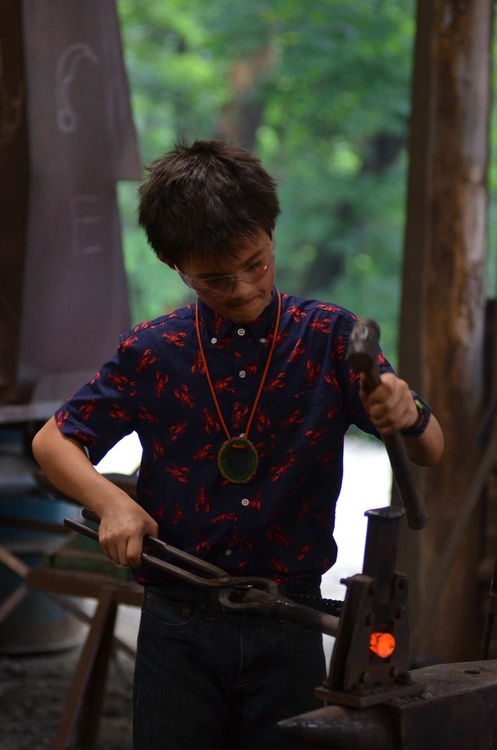 Henry manning the forge at blacksmithing