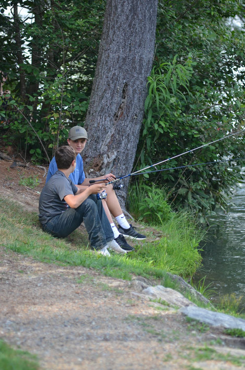 Enjoying camp's serenity with a fishing pole during Free Time today