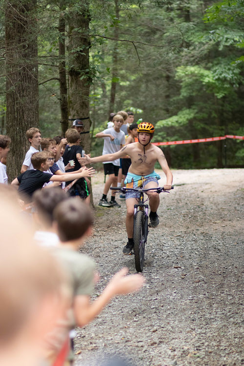 High fives on the 2nd section of the Ironman: mountain biking
