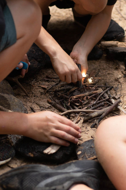 Practicing fire building with flint and steel in OSC