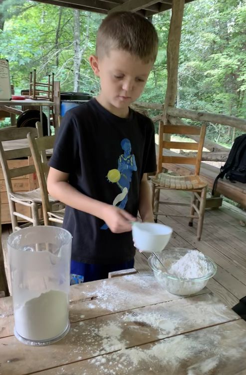 Jack mixing flour, salt, and water to make the simple dough