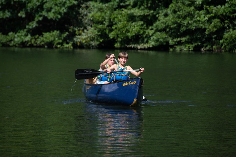 T is also for Teamwork, like when you work together with your canoe partner!